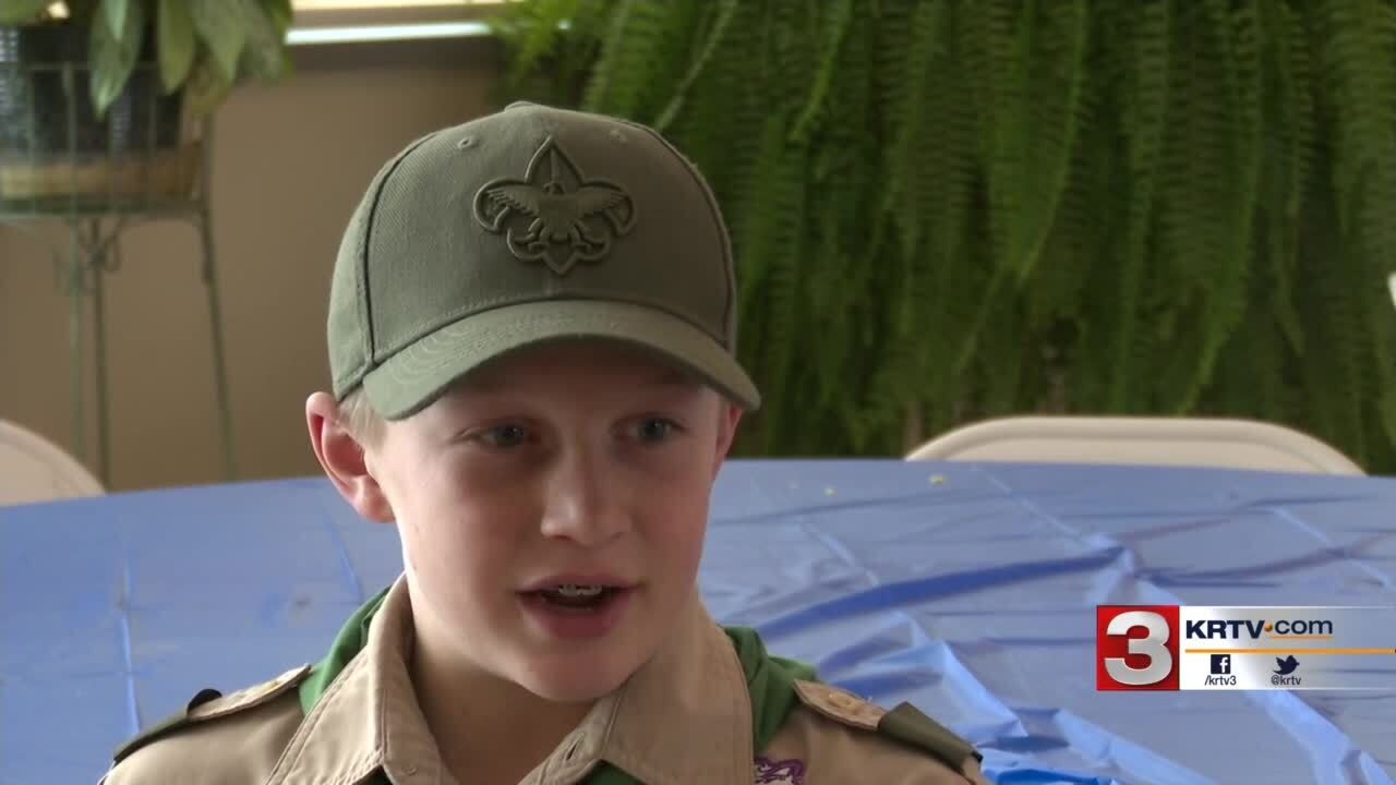 Boy Scouts serve breakfast to men and women of service