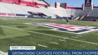 Former UA football athlete catches football from helicopter