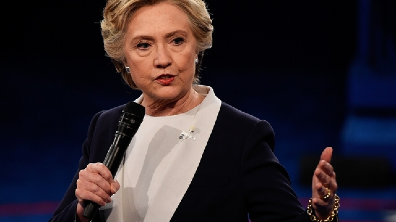 Emails show Clinton treading lightly with Wall Street talks