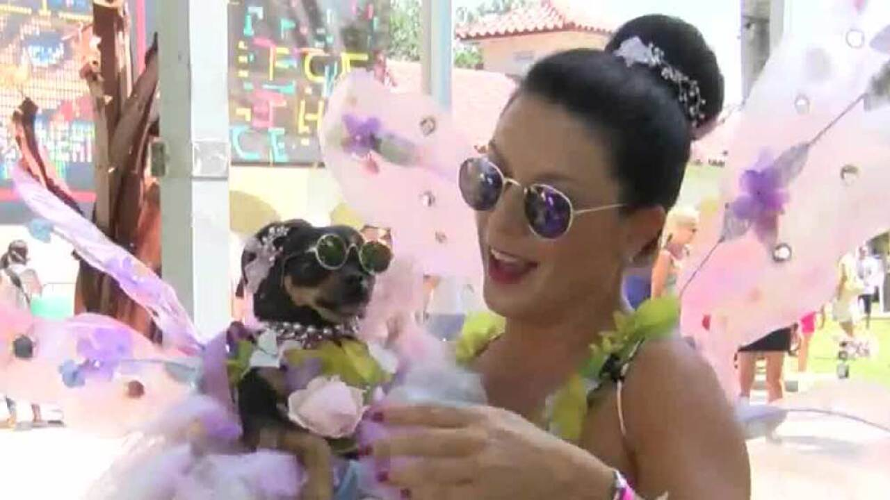 """Rebecca Shelton with her dog """"Presley Shelton"""" at the 2019 Easter Bonnet Pet Parade in Delray Beach."""
