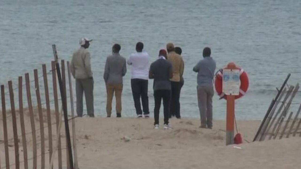 Family and friends of Christian Ngoba during lake search