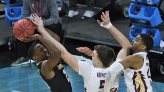 Florida State Seminoles center Balsa Koprivica blocks shot of Colorado Buffaloes guard McKinley Wright IV in 2021 NCAA tournament