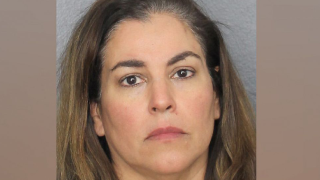 Florida woman calls 911 to report body of 'unknown' woman in driveway, but police say she killed her