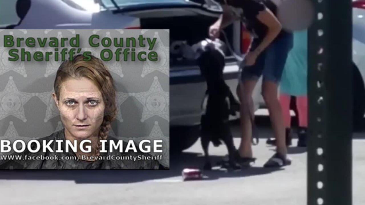 Brevard County woman arrested after video shows her shoving dog in car trunk