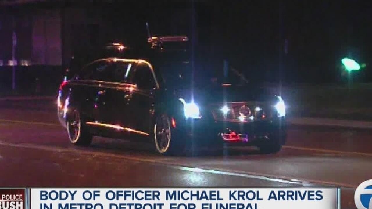 Body of slain Dallas cop being flown home to MI