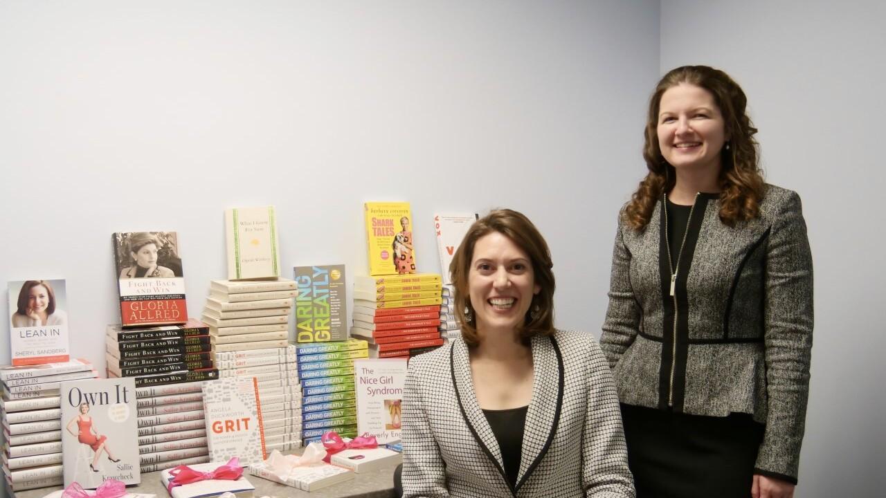Clare and Megan pink ribbon books.jpg