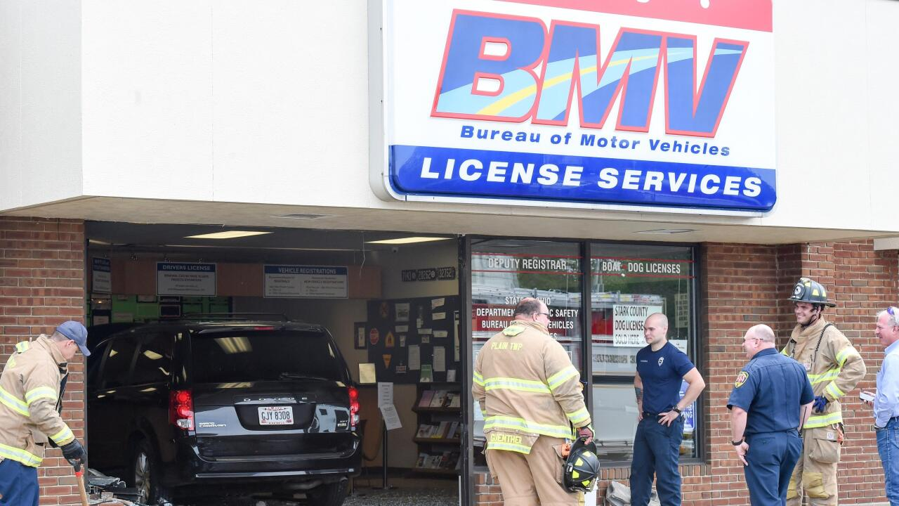 Bmv Akron Ohio >> Drive Up Service Woman Mistakes Gas For Brake Drives Into