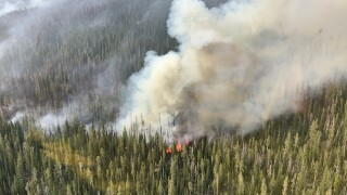Lone Peak Fire near Old Faithful grows to more than 750 acres
