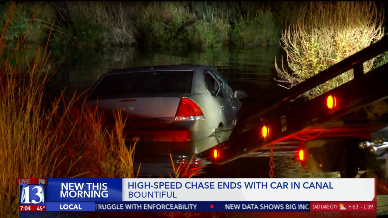 Driver fleeing from Salt Lake City Police crashes into canal inBountiful