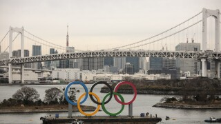 Olympic rings arrive in host city on barge into TokyoBay