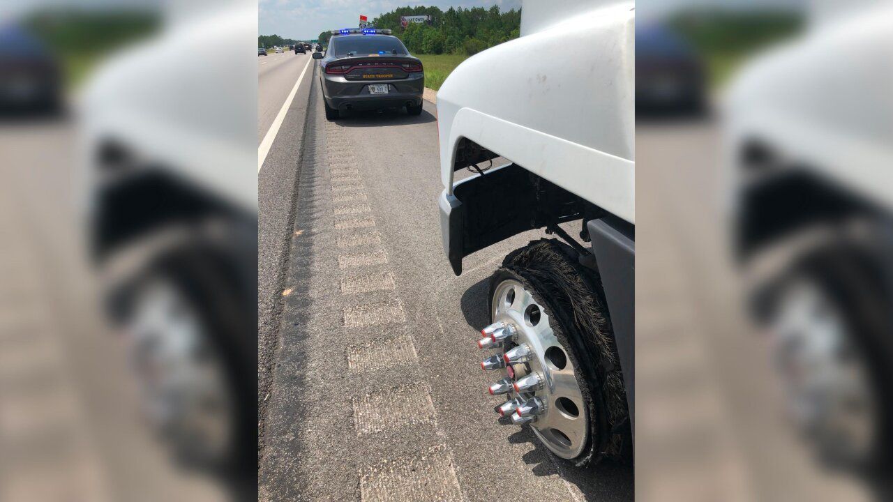 Dozens of tires flattened by container of screws spilled onto highway