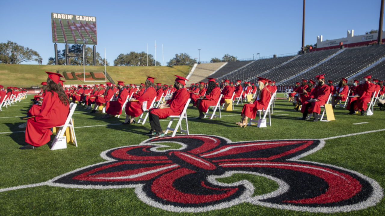 Fall 2020 graduates from the College of Liberal Arts gather Tuesday at Cajun Field for Commencement. The stadium is one of three venues hosting graduation exercises at UL Lafayette. (Photo credit: Rachel Rafati / University of Louisiana at Lafayette)