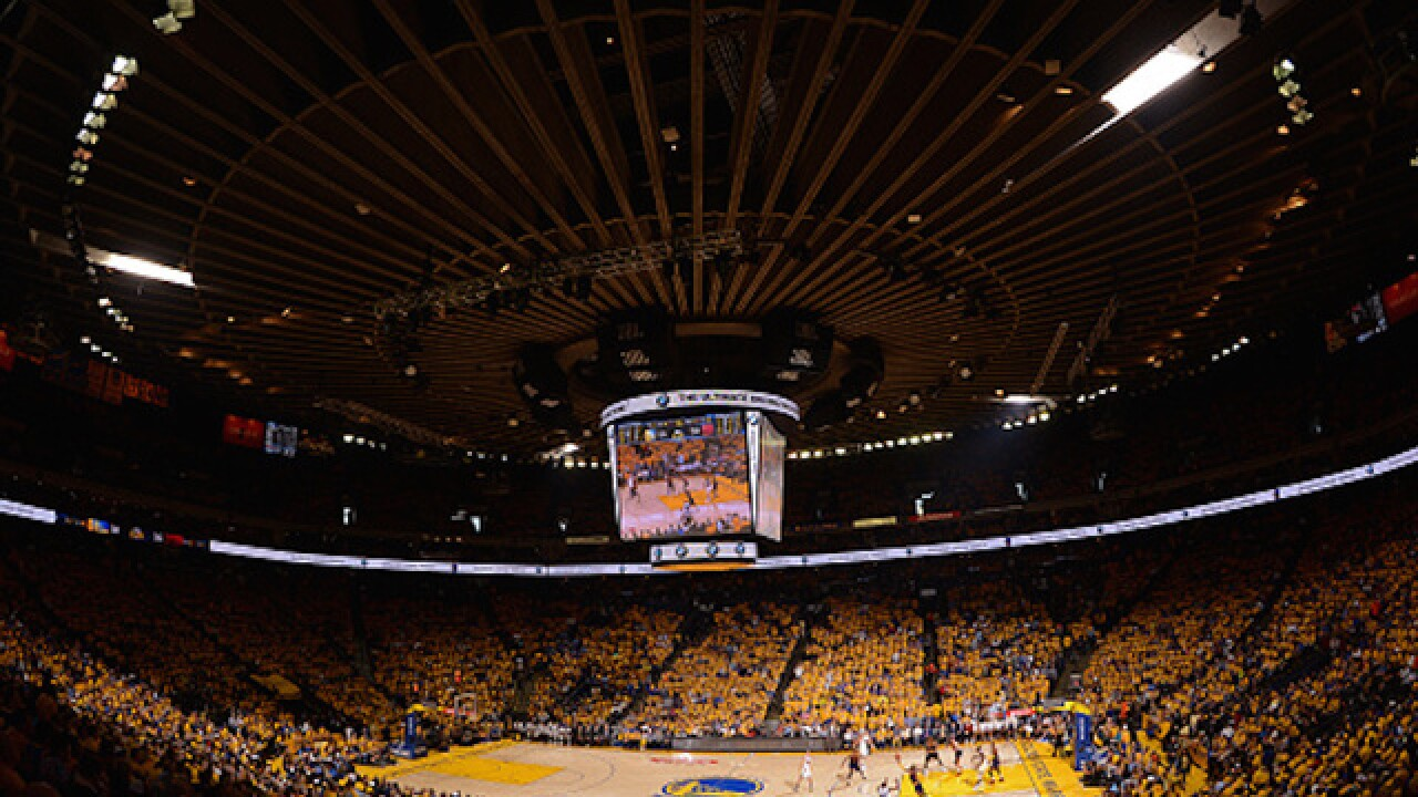 Warriors fan thrown over upper deck of arena in critical condition