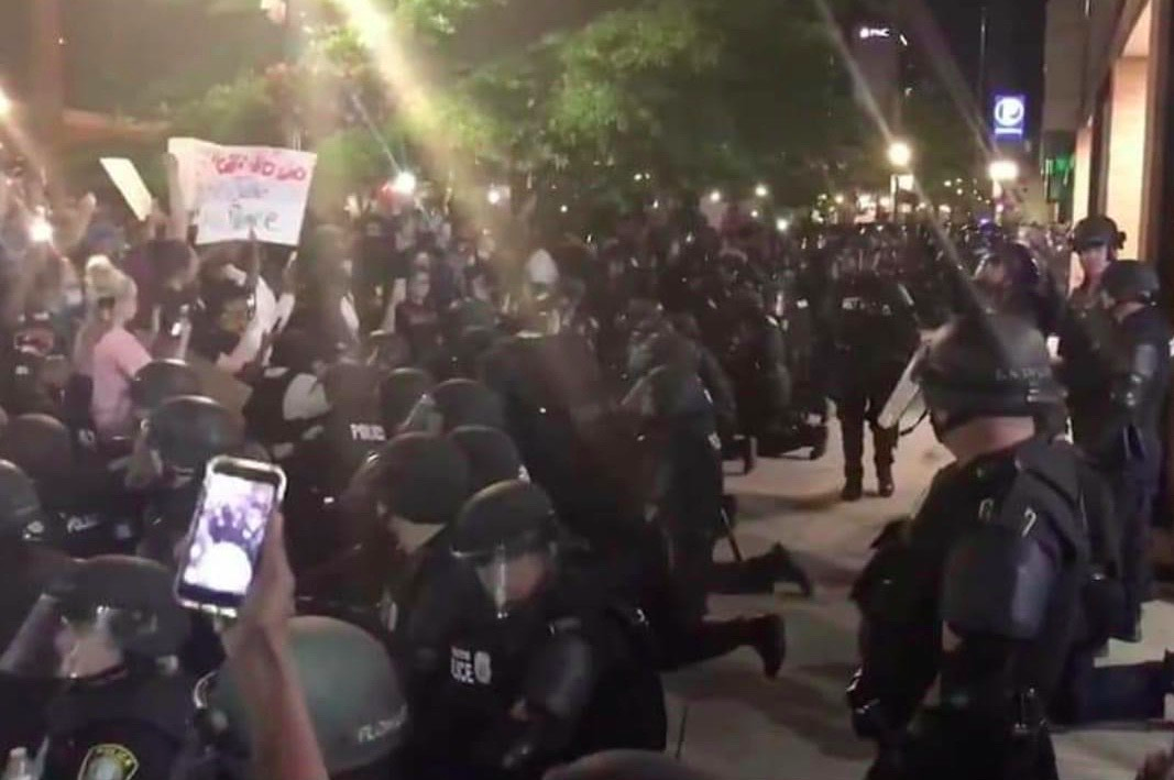 Police kneeling in Lexington.png