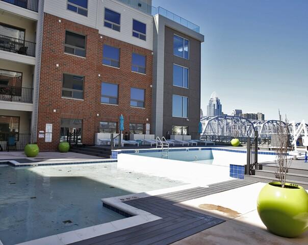 Home Tour: At Aqua on the Levee, awaken to the morning sun reflecting off the Cincinnati skyline