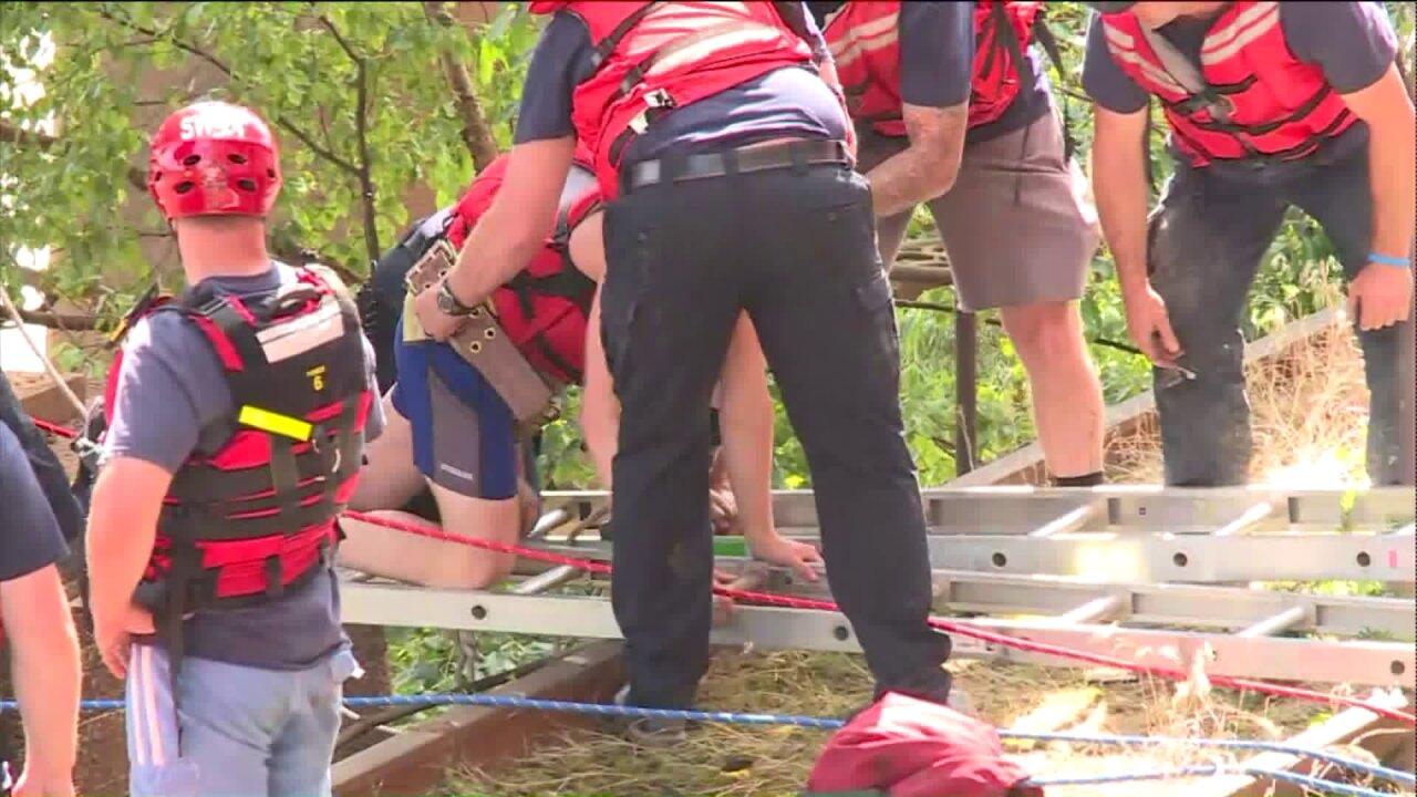 Crews hoist runner from James River near PipelineTrail