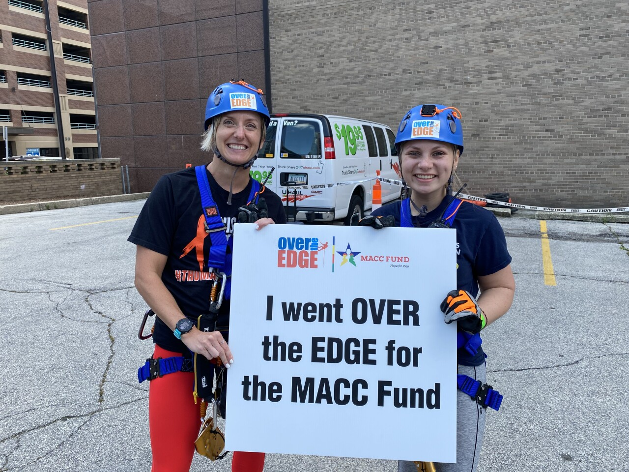 Hollyn Peterson and Kate Moody smiling after rappelling down the Wintrust Building