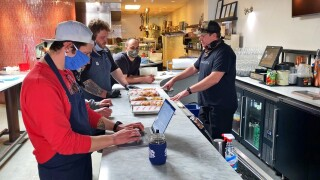 Chefs and cook staff at Bar Dough test new menu items for their new concept 'Jabroni