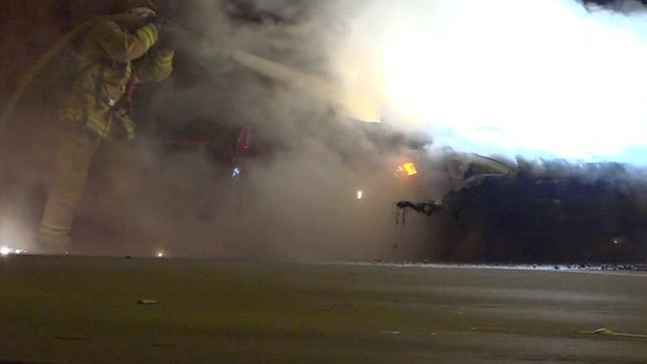 Car explodes into flames while being towed