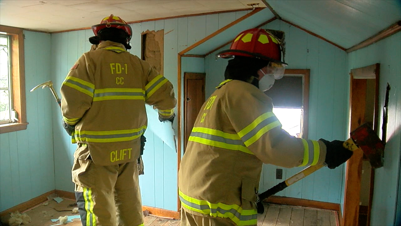Firefighters working on Barracks Project House