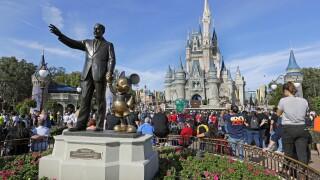 Earns Walt Disney