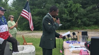 Crossroads Chaplain and US Army Specialist Cardel Clay sharing the history of Memorial Day at Madison Healthcare today.jpg