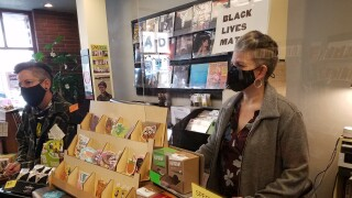 Chelsia Rice answers customer questions at Montana Book Company