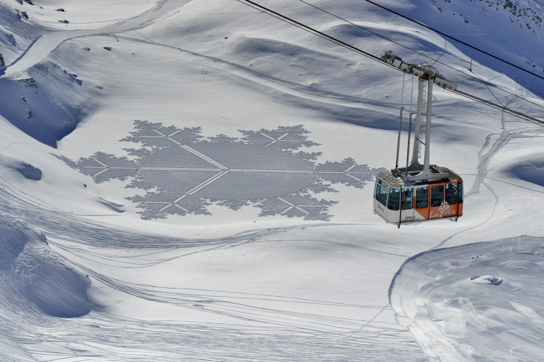 Photos: Artist uses snow as canvas for massive geometricaldesigns