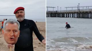 Curtis Sliwa of New York's Guardian Angels swims at the Coney Island beach Sunday, May 24, 2020, to protest New York City Mayor Bill de Blasio not opening city beaches for swimming and more amid the COVID-19 pandemic.