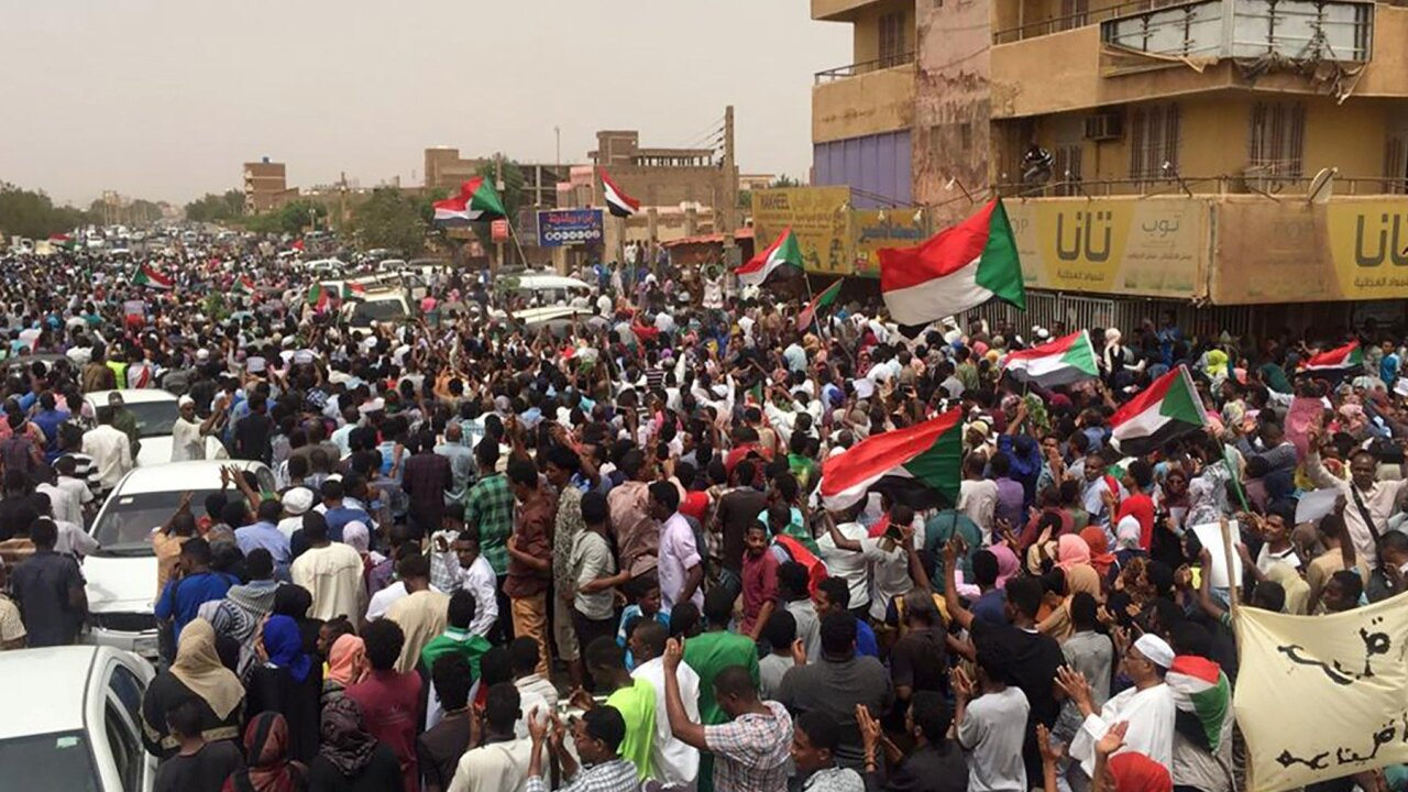 At least 7 dead as tens of thousands protest in Sudan, demanding civilian rule