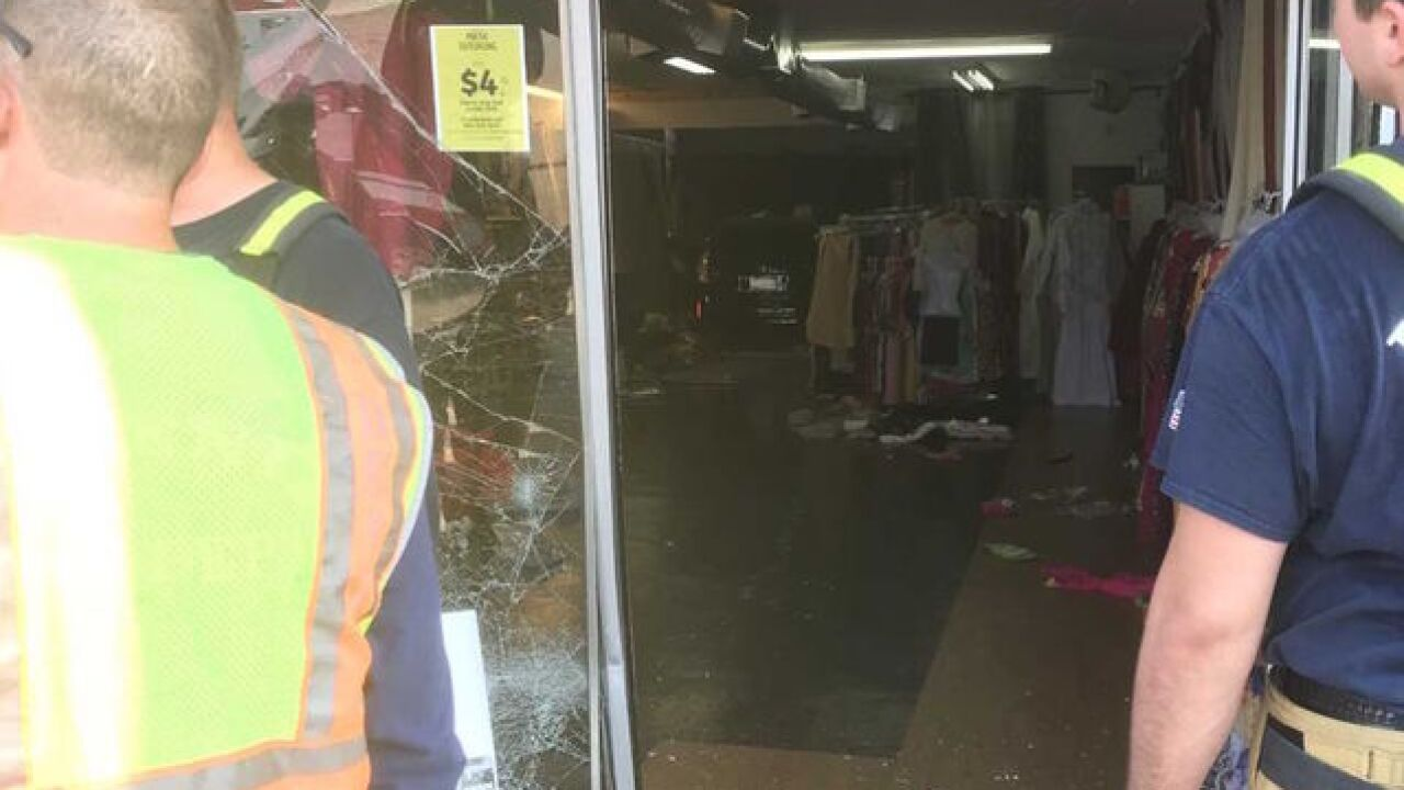 FD: 2 kids hurt after vehicle crashes into store