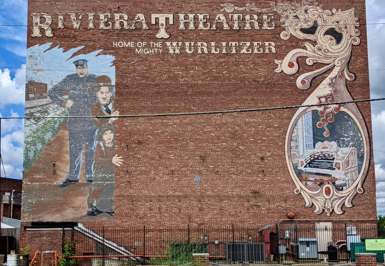 Old mural that used to exist on the site of the Riviera Theatre.