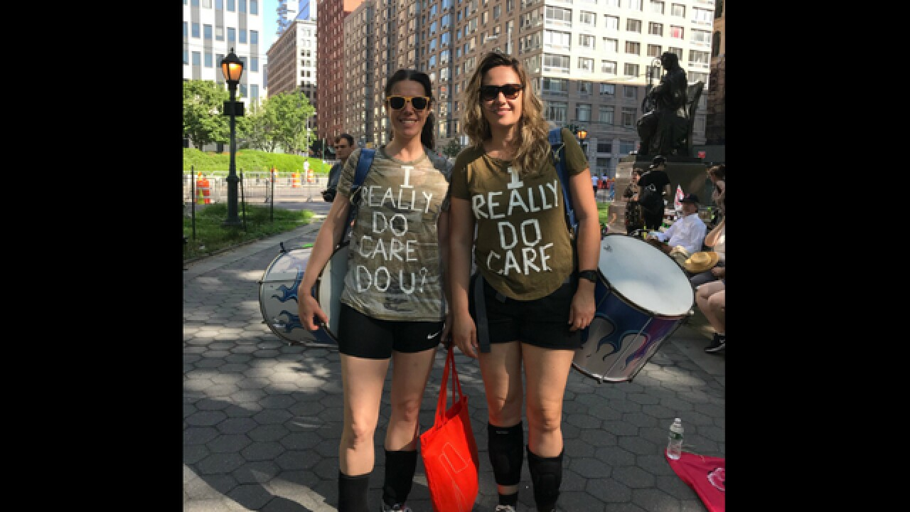 'I do care' shirts troll Melania Trump at immigration protests