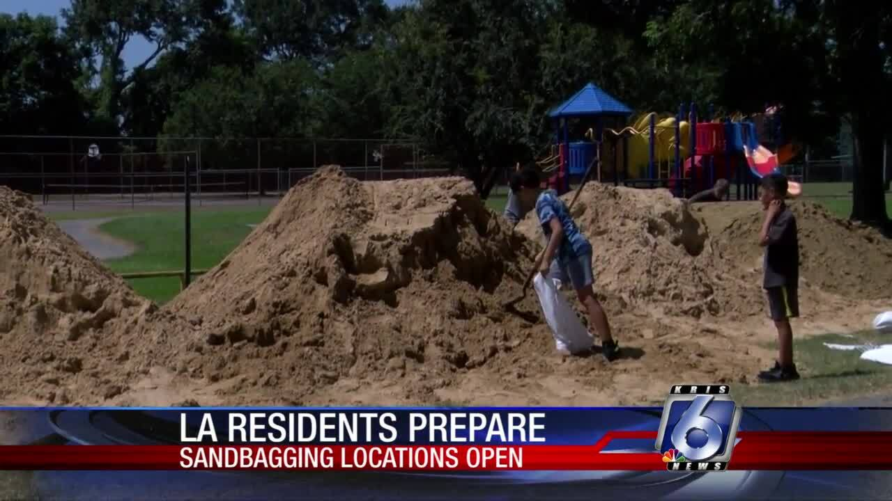 Louisiana residents prepare for Marco, Laura