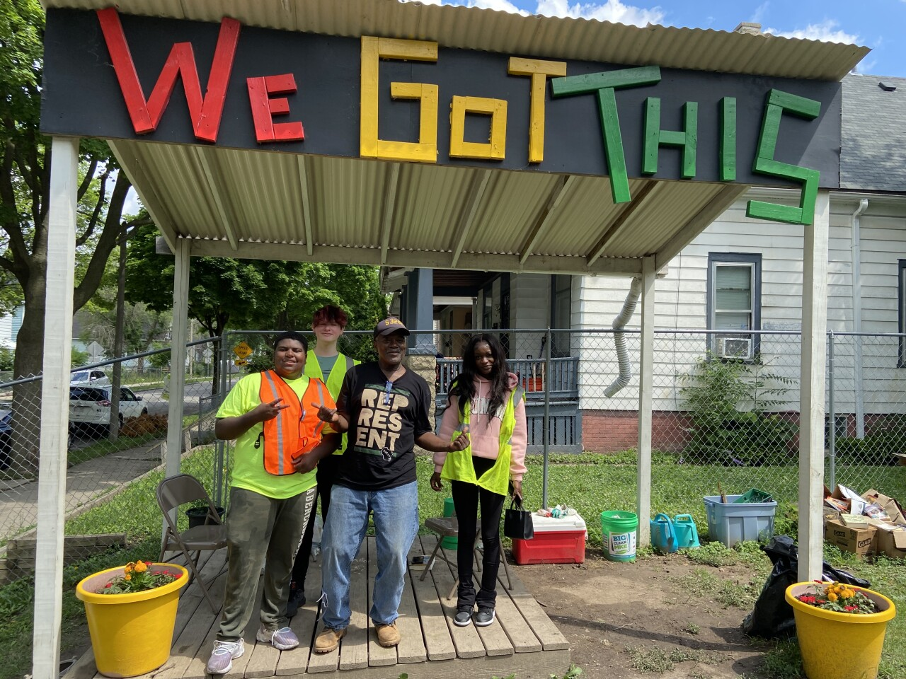 Andre Lee Ellis with youth workers at We Got This garden