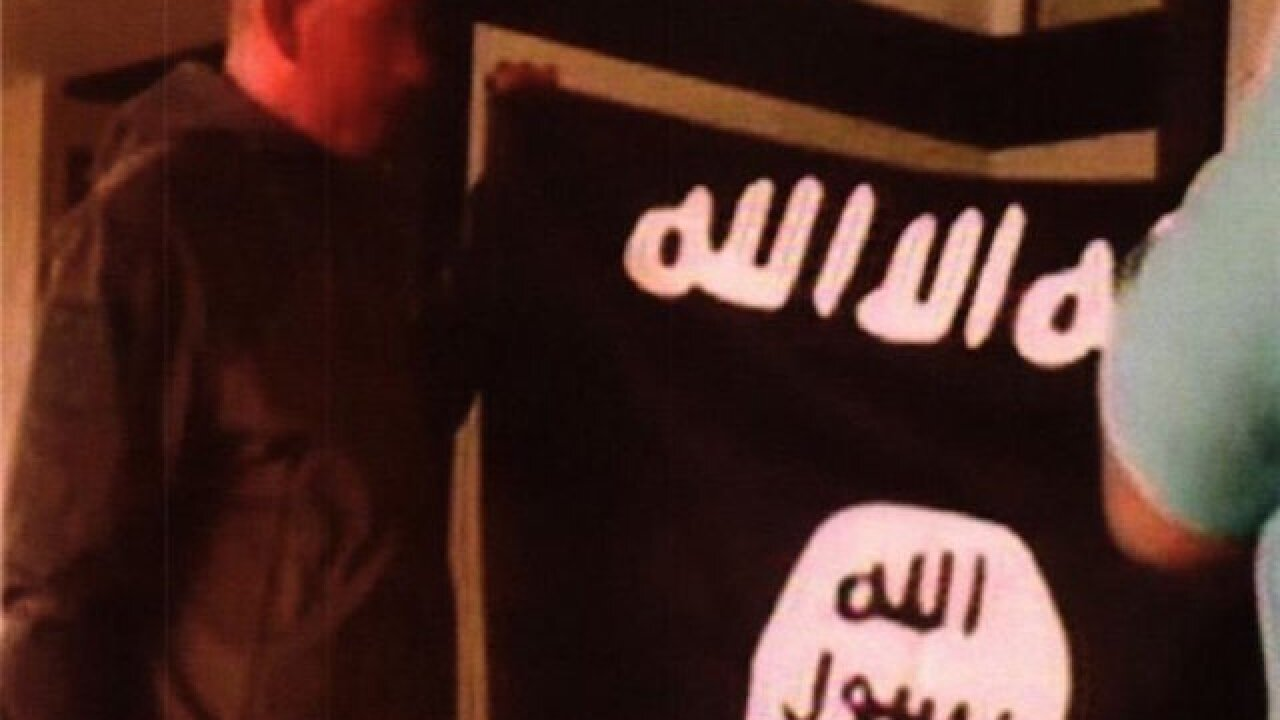 Photos: Arrested Army soldier kissing ISIS flag