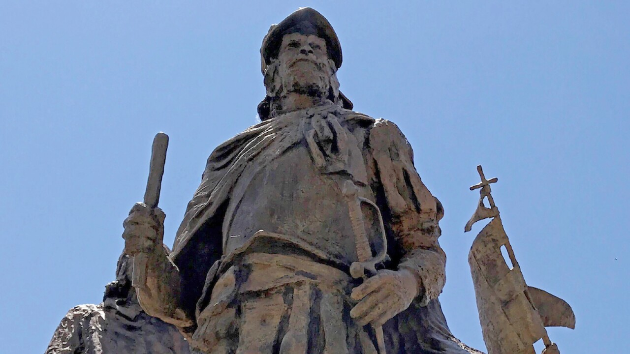 Member of armed group shoots protester trying to tear down statue of conquistador in Albuquerque