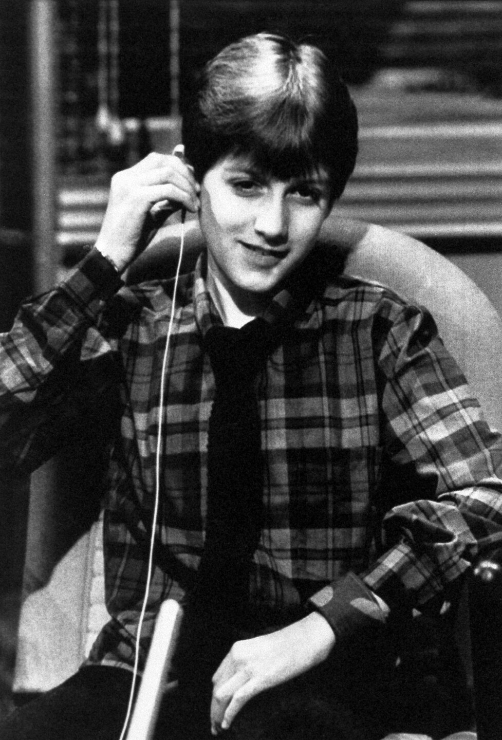 """Ryan White, 14, from Kokomo, Ind., a hemophiliac who contracted AIDS through blood transfusions, adjusts an earphone for the simultaneous translation during a live interview in the state-run RAI-TV studios, February, 3, 1986 in Rome, during the broadcast of the magazine program """"Italian Sera."""" (AP Photo/Bruno Mosconi)"""