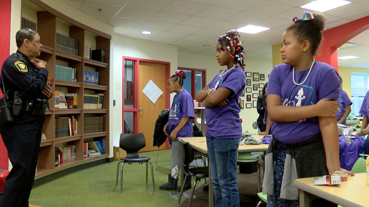 Cincinnati Police Officer Princess Davis speaking to girls from Ethel M. Taylor Academy