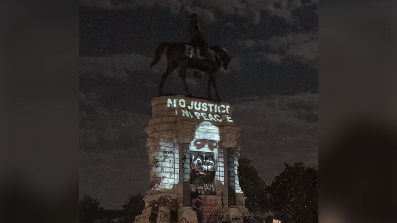 Image of George Floyd projected onto statue of Robert E. Lee in Richmond, Virginia