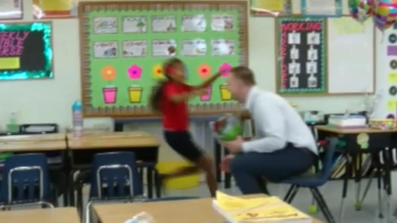 Coast Guard member surprises daughter at school for birthday