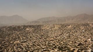 Dozens killed as blasts rock Kabul