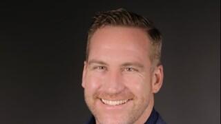 Q2's Brandon Sullivan wins national reporting award for state wrestling story