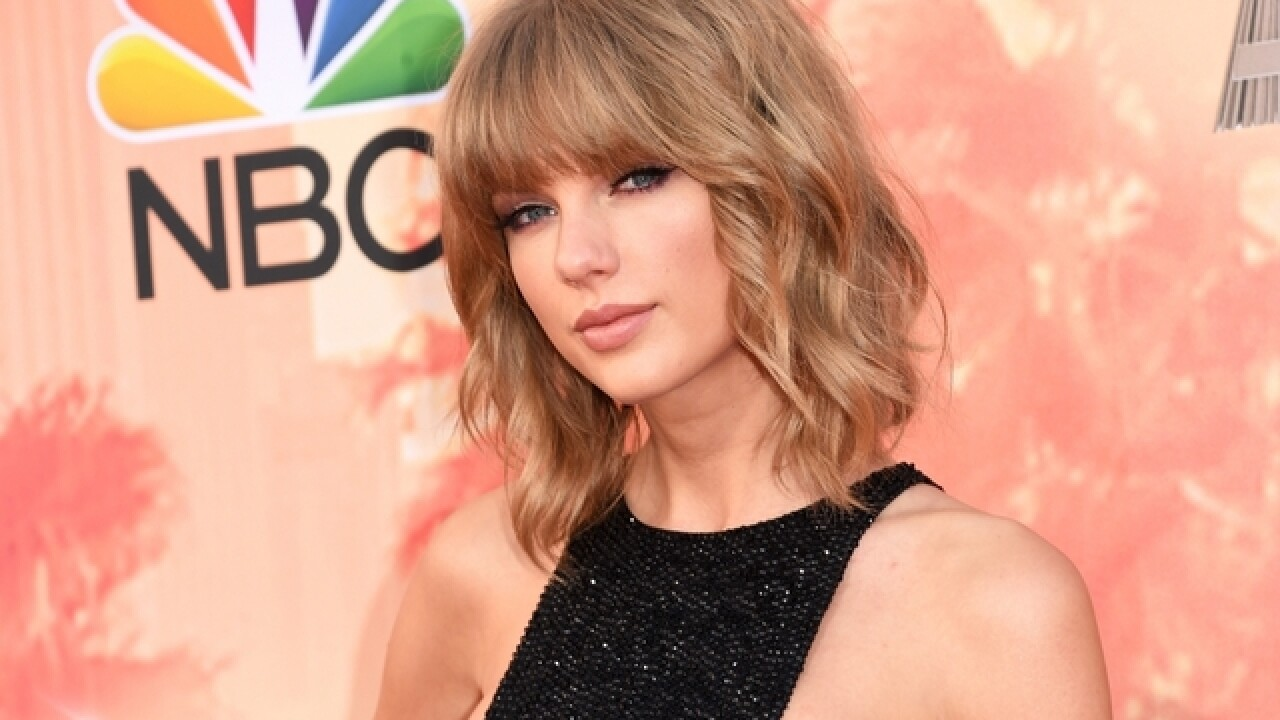 Police: Man detained outside Taylor Swift's home