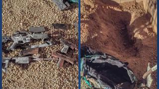 Guns found in buried duffle bag.png