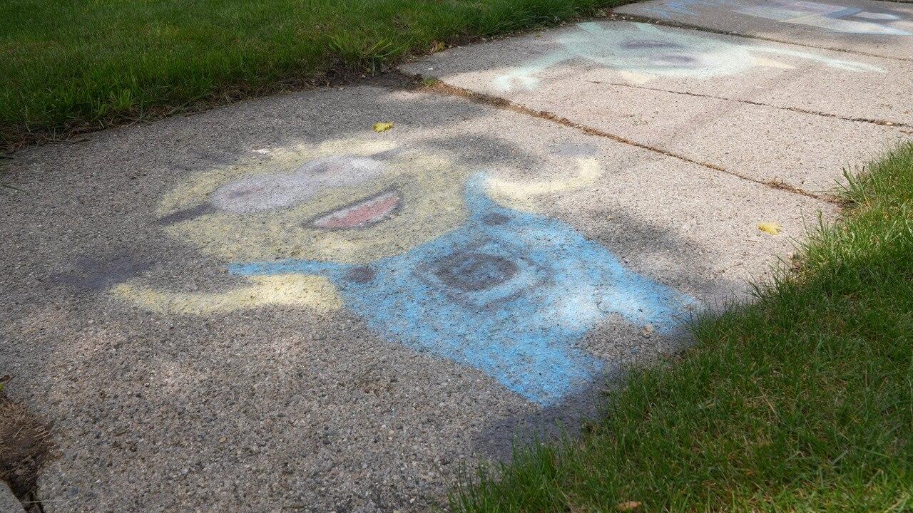 Sidewalk chalk art on Maplewood Avenue in Lansing