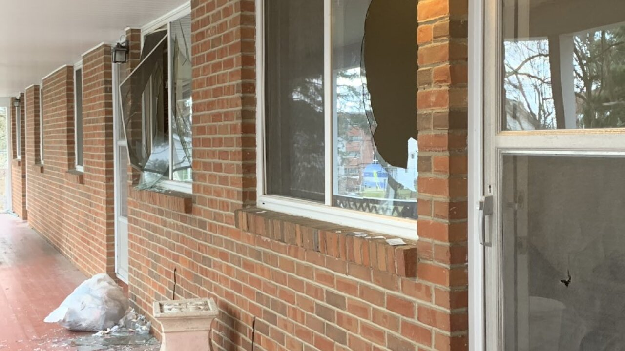 Broken windows on the second floor of an apartment building in Mansfield, the scene of an officer-involved shooting.