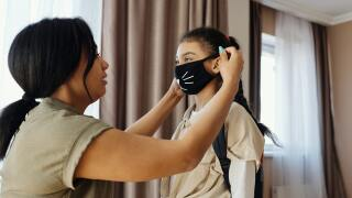 mother-putting-a-face-mask-on-her-daughter-4261252.jpg
