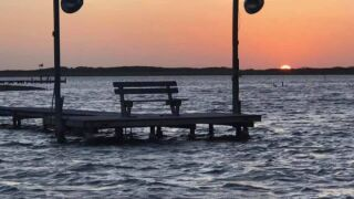 Sunset and a lonely pier - Photo By: FB Weather Watcher Julie Salazar