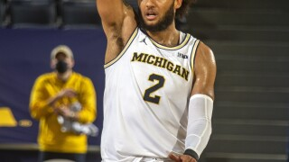 Michigan survives Oakland upset bid in overtime 81-71